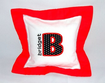 Personalized red border pillow with name and applique mongram