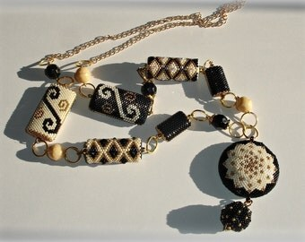 Necklace necklace beads woven black and gold