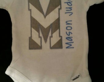 Onesie with appliqued initial and name embroidered