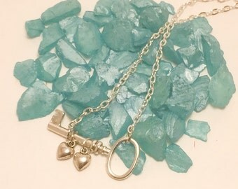 Key and heart charm necklace