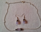 Necklace & earrings of violet opal AB Swarovski crystal cubes hugged by clear crystal squaredelles and metallic purple bicones. Silver chain
