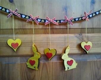 Ribbon garland with wooden rabbits and hearts hanging decoration