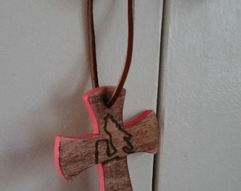Small cross with pink edging and burned in barrel racer