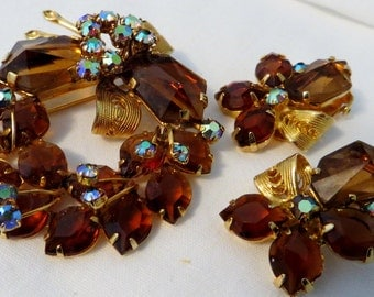 From Australia brooch and clip on ensemble, smoky topaz A/B rhinestones and gold tone filigree.
