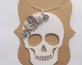 Laser Cut Skull Necklace with Silver Flowers and Shells