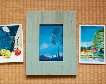 Set of 3 pictures and a wooden green picture frame.