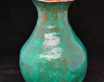 Hand raised copper vessel