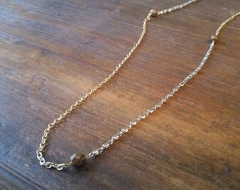 Gold and Silver Drape Chain with Bronze Fire Polished Bead detail