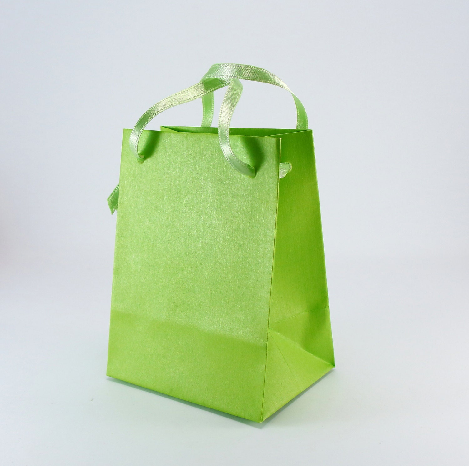 Lime green paper bags with handles