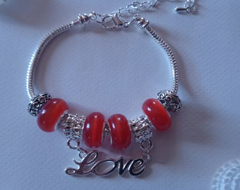 "Charm's orange charm bracelet with ""love"" ref 330"