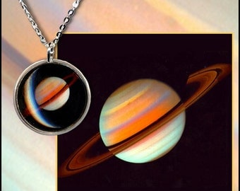 Saturn pendant on sterling silver chain with high quality photo gift card and black jewellery box.