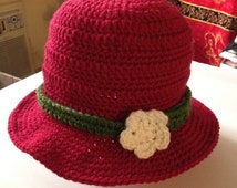 Beautiful red hat for Spring in red with green ribbon and white flower; fit for five to nine-year old girls