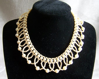 Vintage necklace of pearls ended with a black velvet ribbon