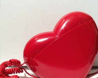 Heart shaped vintage telephone in New condition (dead stock) for shooting