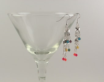 Rainbow colored Swarovski crystal tiered earrings with silver accents.