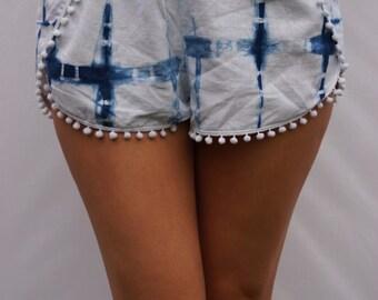 Indigo pompom shorts with wrap over detail. Indigo square pattern.
