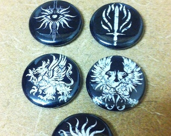 your choice of four dragon age symbol buttons !