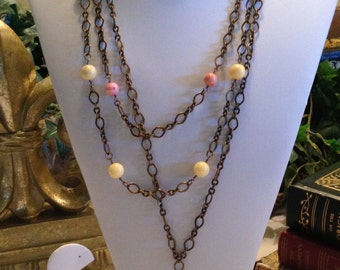 Multi-tiered brass and ceramic beaded necklace