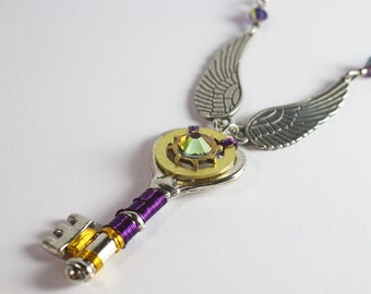 Steampunk skeleton key pendant with watch parts, metal wire and crystals