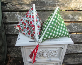 A pair of menstrual cup pouches Strawberry Basket