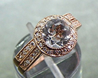 AAA White Topaz Natural untreated   7mm  1.71 Carats   in 14K Rose gold Diamond halo bridal set with .35cts of diamonds. B007