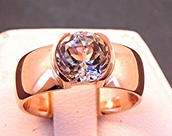 White Tourmaline   7.00mm  1.56 Carats   in 14K rose gold ring. 1038