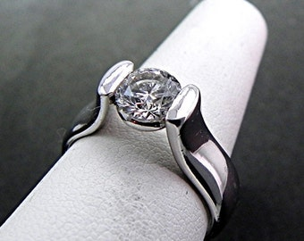AAAA Moissanite 6mm Round 14K white gold Tension set engagement ring. MMM