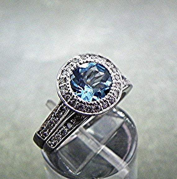 AAA Round Blue Topaz   7mm  1.39 Carats   18K white gold bridal set. B007 0365