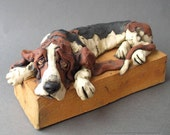Basset Hound Dog Drooping Over Base Ceramic Sculpture