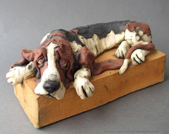 Basset Hound Dog Drooping Over Base Ceramic Sculpture