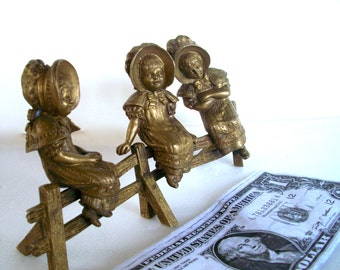 Vintage Brass Sculpture 3  Pioneer Girls On Fence Measures  6 And 1/8  X  3.5  X  1 And 3/8 Inches