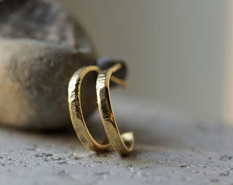 Small 18K gold hoops with hammered texture. Yellow gold hoop earrings with posts.