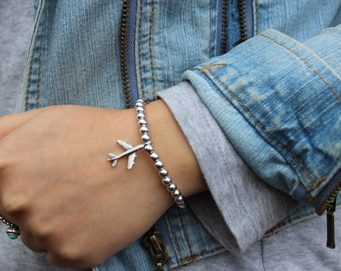 The Wanderlust Travel Bracelet in Silver.