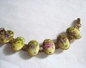 "Hand Painted Flower  Bracelet Gold Tone 7"" x 1""."