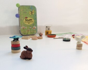 Play is learning. Activity box of tiny toys for kids imagination play, quiet play, and travel. Busy box.