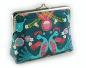 Folk inspired purse on emerald green
