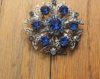 Vintage 60's Silver Filigree Sapphire and Baby Blue Crystal Brooch by Celebrity NY