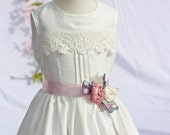 White flower girl dress with lace and pink ribbon rose sash