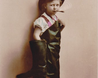 Just a Puff- Boy Smoking Cigar- 1910s Antique Photograph- Slack Times- Real Photo Postcard- Hand Tinted RPPC- Leather Boots- Paper Ephemera