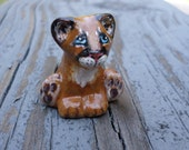 miniature mountain lion, miniature puma, puma, mountain lion, cougar,  animal totem