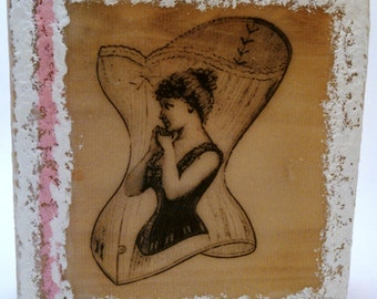 Lula: An encaustic mixed media painting on re-purposed wood