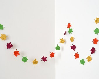Garland with leaves in yellow gold, orange, green and purple burgundy cardboard