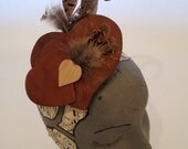 Beautiful unique soft tan leather hearts feather fascinator hat wedding races