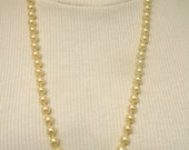 Long Ivory Pearl Strand Necklace