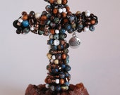 Beaded Cross made of Annealed Steel Wire.  Agate and wood beads mounted in Dyed Quartz.
