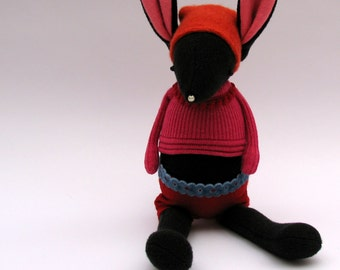 SALE  -  Black Woollen Rabbit - Handmade plush sculpture wearing pink woollen pullover and felt shorts.
