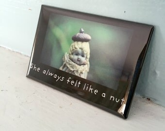 """Refrigerator Magnet Adventures of Claudia Porcelain Doll """"She Always Felt Like A Nut"""" Typographic Magnet"""