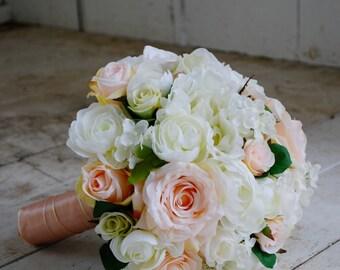 Silk bridal bouquet, peach roses, white roses, ranunculus, hydrangeas