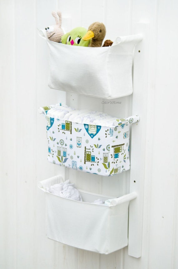 items similar to hanging nursery storage diaper caddy