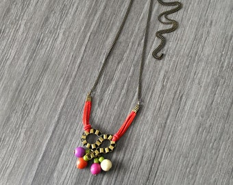 African pendant necklace. Gold brass long pendant. Beaded necklace. Colorful Geometric necklace. Beadwork necklace.